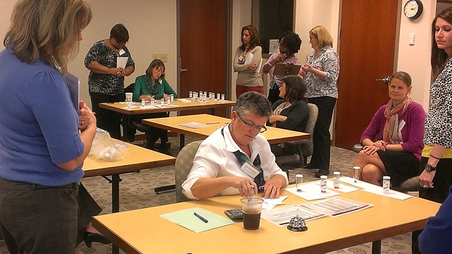 QI Advisors participating in a workshop simulation activity.